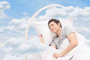 Man sleeping on a bed in the clouds